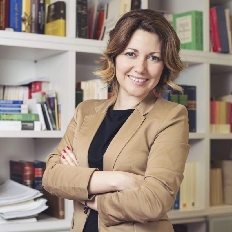 Researcher in front of bookshelf - Academic Transcription