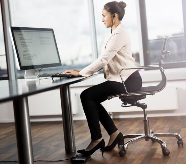 Professional Typist working on her computer
