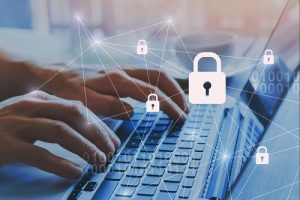 person typing on keyboard with padlocks superimposed over image, representing safe and secure IT systems